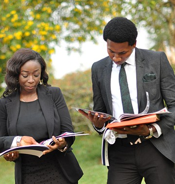 BIU-graduates-reading-in-field